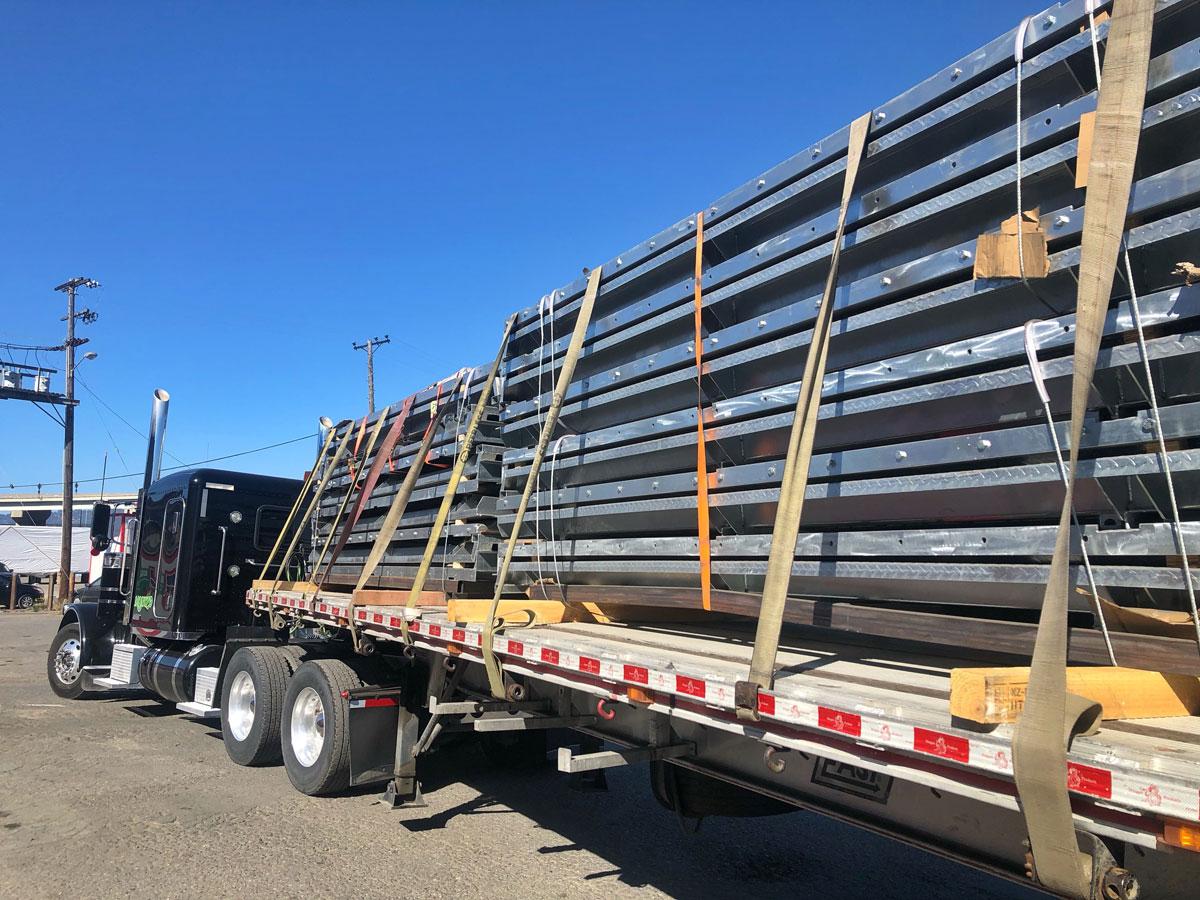 impact straps load semi truck